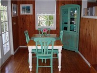 The dining area is close to the kitchen for easy serving.  A great place to gather and plan your days activities!