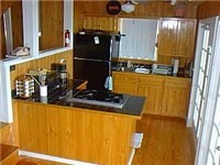 The kitchen has modern appliances and is next to a dining area or the deck for easy entertaining or dining.
