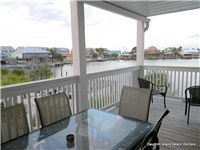 Great covered deck off main level with water views
