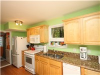 The home features a fully equipped galley kitchen.