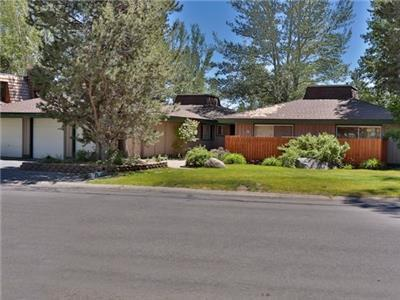 Beautiful Tahoe Keys property with boat dock.  Across the street from the beach/lake.