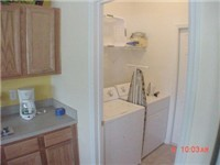 Laundry room with iron, ironing board and of course washer and dryer.