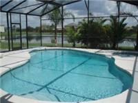Lovely sparkling pool backs to lake