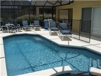Large pool and spa with plenty of seating and lanai for enjoying meals around the pool