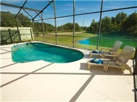 Lovely pool that backs to small lake for privacy