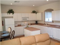 Large and spacious kitchen overlooks family room.