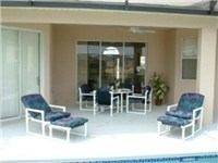 Covered lanai for enjoying meals or poolside drink