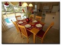 Dinning area overlooks pool