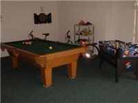 Game room with pool, elec. darts and foosball.