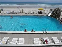 One of two large and lovely outdoor pools that overlook the ocean. Steps away from the beach... Plus a heated spa
