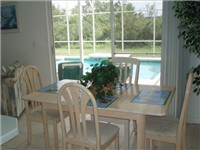 Dinette area. Enjoy your morning coffee overlooking the pool deck.