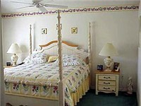 Bedroom with queen / Two more rooms with a set of twins in each room.