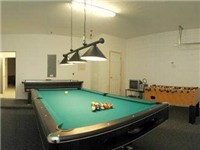 Game Room with Pool Table and Foosball Table