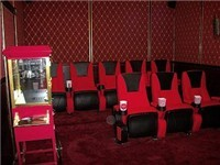 Nice relaxing movie chairs and popcorn machine for enjoying home movies