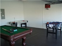 Game room  with pool, foosball and air-hockey.