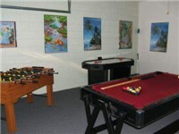 Game Room with Pool Table, Foosball, Air Hockey.