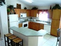 Fully equipped kitchen with counter seating.