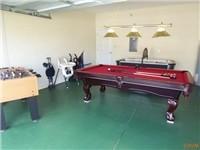 Game Room with Pool Table, Air Hockey, Foosball.