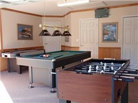 Game room with foosball, billiards and air hockey.