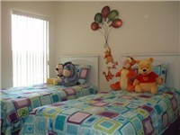 Twin Bedroom with full adult sized beds in a themed room.