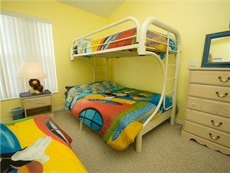 Kids Room with Bunk on Top and full on bottom, plus a twin bed.