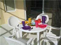Enjoy a poolside meal or drink