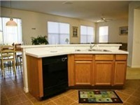Kitchen with views of family room, dinette and pool area