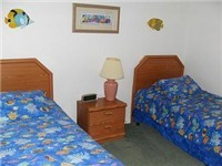 One of two twin bedrooms with adult size twin beds