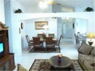 Large and spacious living room and dinning area. cathedral ceiling for that open and spacious feel.