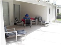 Nice covered lanai for enjoying a drink or meals poolside