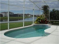 Sparkling pool overlooks lake for lovely views.