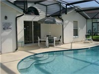 Sparking pool with plenty of room for lounging and enjoying meals by the pool.