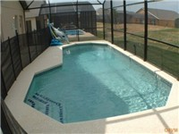 Large sparkling pool with child proof screen/gate around pool.