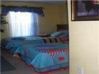 One of Two Twin Bedrooms / 4 Twin Adult Beds