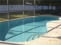Large sparkling Pool and nice shaded lanai for enjoying outdoor meals around the pool.