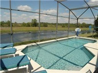 Large and Sparkling Pool that backs to small lake