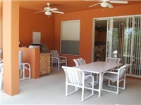 Great covered lanai for enjoying your meals poolside.