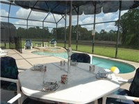 Large covered lanai for enjoying your meals outdoors around the pool.