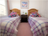 This fully furnished bedroom is situated in the 3rd wing of the house and has 2 single beds and large fitted wardrobes with again its own TV and DVD player
