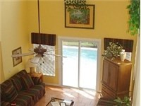 Large spacious living area with cathedral ceilings.