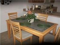 Kitchen overlooks dinette table