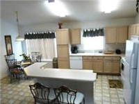 Large and lovely kitchen with dinette area and kitchen bar.
