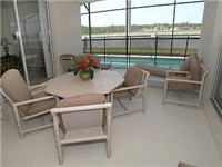 Large lanai that overlooks pool. Great for having enjoying a drink and meals poolside.