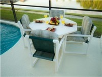 Enjoy your morning coffee or a nice meal by the pool with lovely lake views.