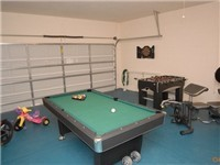 Game Room with billiards, foosball and darts.