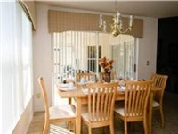 Dinette with lovely views of the pool and deck