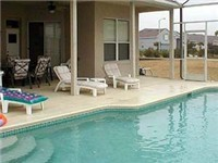 Very large pool with a nice covered deck/lanai area.