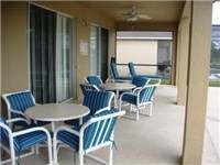 Nice covered lanai. Enjoy meals or poolside drink