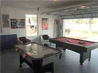 Game room  with billiards and air hockey