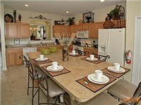 Kitchen with large table for enjoying your meals or playing games.